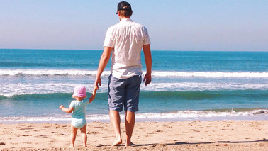 105-nm-dad-and-baby-on-beach-tease-170601.jpg